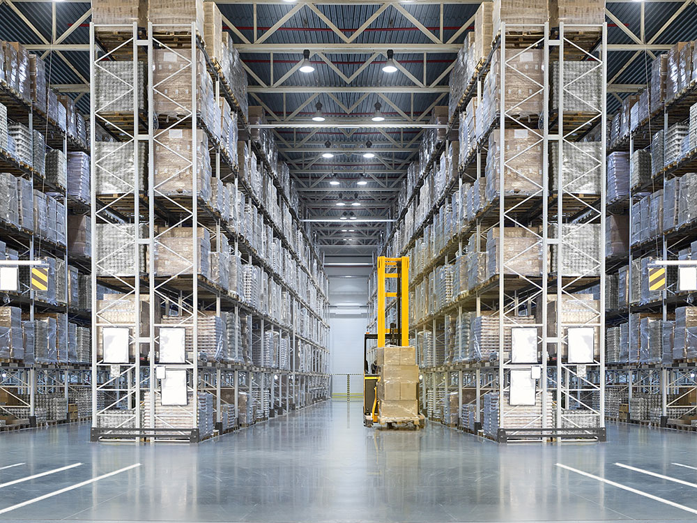 Large warehouse pallet racking system with forklift