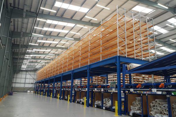Industrial mezzanine floor above factory machinery